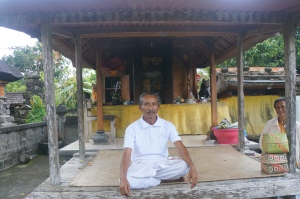 Pak Mangu in front of the temple in the compound